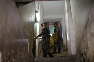Brazilian soldiers inspect a house for the Aedes aegypti mosquito in Recife