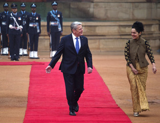 German President Gauck walks on the red carpet during his ceremonial reception in New Delhi