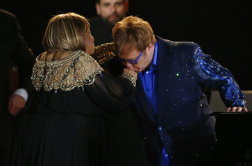 """Elton John kisses Mavis Staples' hand after performing """"The Weight"""" at the 55th annual Grammy Awards in Los Angeles"""