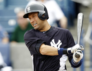 New York Yankees Derek Jeter swings the bat as he returns to the lineup as the designated hitter during a Grapefuit League game against the Atlanta Braves in Tampa
