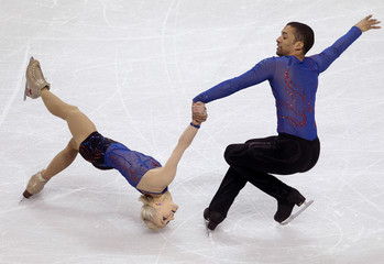 Savchenko and Szolkowy of Germany perform their pairs short program at the ISU World Figure Skating Championships in London