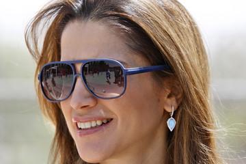 Jordan's Queen Rania watches a women soccer match during a 1Goal campaign in Amman