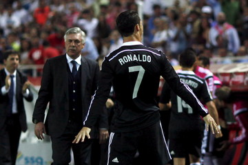 Real Madrid's Ronaldo celebrates his third goal against Sevilla while coach Ancelotti watches him during their Spanish first division soccer match in Seville