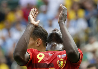 Belgium's Romelu Lukaku reacts after missing a chance to score during their 2014 World Cup Group H soccer match against Russia at the Maracana stadium in Rio de Janeiro