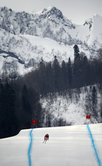 Switzerland's Zurbriggen speeds down the course during the downhill run of the men's alpine skiing super combined training session at the 2014 Sochi Winter Olympics