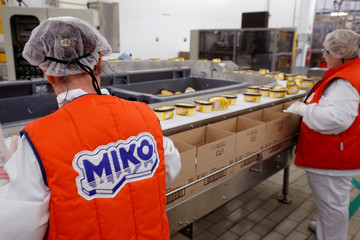 Employees prepare boxes of ice cream at the Miko Carte d'Or, part of the Unilever group, factory in Saint-Dizier