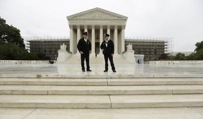 Policemen talk in front of the U.S. Supreme Court in Washington