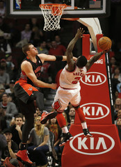 Chicago Bulls' Robinson is fouled by Toronto Raptors' Valanciunas during the first half of their NBA basketball game in Chicago, Illinois