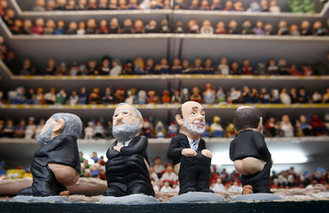 "Clay figures known as ""caganer"",representing Spain's PM Rajoy and main opposition Socialist Party leader Rubalcaba are displayed at the Santa Llucia Christmas market in central Barcelona"