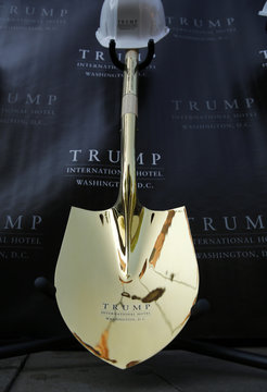 Trump shovel and hardhat for ground breaking of new hotel in Washington