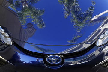 Palm trees are reflected in the Toyota Mirai, Toyota Motor Corporation's first commercially available, mid-sized hydrogen fuel cell sedan, at a press preview in Newport Beach