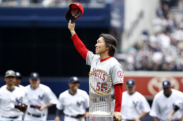 Matsui of the Los Angeles Angels of Anaheim tips his cap after receiving his 2009 World Series ring in New York