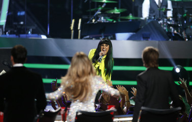 """Finalist Jena Irene performs """"Decode/Ain't it Fun"""" during the American Idol XIII 2014 Finale in Los Angeles"""