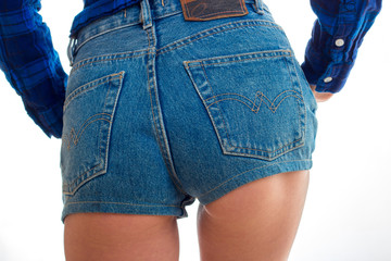 women's booty in denim shorts close-up
