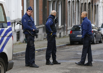 Police officers stands on a roadblock in Verviers