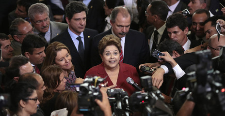 Brazil's President Rousseff speaks to the media after a ceremony for the new law, the Programa Mais Medicos, at the Planalto Palace in Brasilia