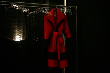 A red coat is seen backstage before the Charlotte Ronson Fall/Winter 2011 collection show during New York Fashion Week