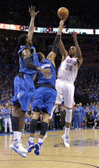 Oklahoma City Thunder's Durant shoots the game's winning shot during the NBA playoff basketball game in Oklahoma City