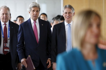 Kerry talks with Hammond as they arrive to participate in the first working session of the G7 foreign minister meetings in Hiroshima, Japan
