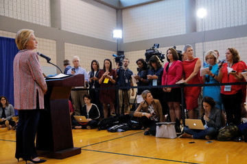 U.S. Democratic presidential candidate Hillary Clinton listens to a question from a reporter at a news conference in Greensboro
