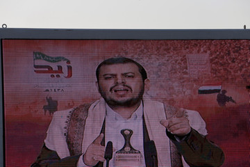 Abdul-Malik al-Houthi, leader of the Houthi movement, delivers a speech on a screen to followers during a rally commemorating the death of Imam Zaid bin Ali in Sanaa, Yemen