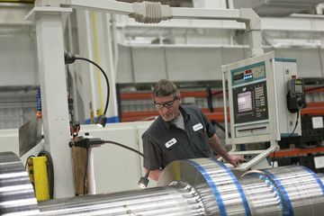 An employee with Siemens Energy works on a component for a turbine at Siemens Energy's plant in Charlotte