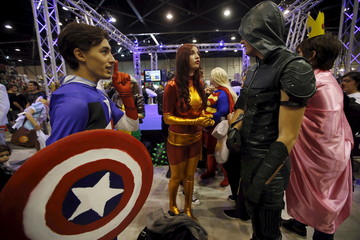 Participants dressed in superhero costumes pose for a picture during the second edition of the Hero Festival in Marseille, France
