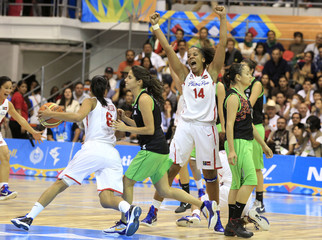Mari Placido of Puerto Rico celebrates after they defeated Mexico in their women's final basketball game at the Pan American Games in Guadalajara