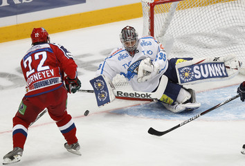 Russia's Korneev shoots at Finland's goaltender Lassila during their Channel One Cup ice hockey game in Moscow