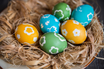 colorful eggs in a wicker nest