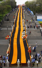 Activists hold a St. George's Ribbon, a symbol widely associated with the commemoration of World War Two, 142 meter long in the centre of Ukrainian Black Sea port of Odessa