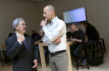 Apple Inc.'s Bridger talks with San Francisco Mayor Lee at Apple's flagship retail store in San Francisco