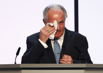 Swiss pharmaceutical company Roche outgoing chairman Franz Humer wipes his eyes during the annual general meeting in Basel