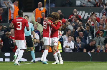 Manchester United's Marouane Fellaini celebrates scoring their first goal with Marcus Rashford