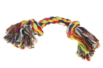 Colored  woven dog rope toy on a white background