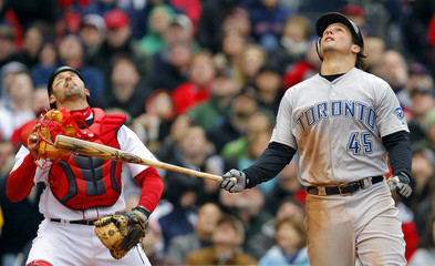 Toronto Blue Jays Travis Snider and Boston Red Sox catcher Jason Varitek look up at a foul ball during the fourth inning of their MLB American League baseball game at Fenway Park in Boston