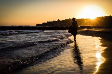 Women walking the beach during sunset