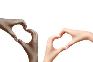 African and white female hands show heart on white background.