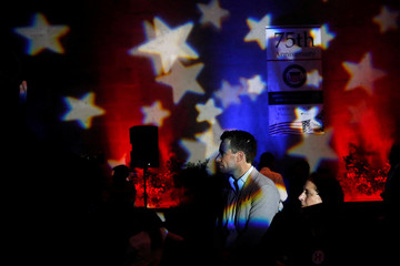 People watch a broadcast of the U.S. presidential race between Democratic nominee Hillary Clinton and Republican nominee Donald Trump in a restaurant in Mexico City