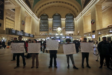 Black Lives Matter protesters hold signs in Grand Central Terminal as they protest the 2014 death of Laquan McDonald from Chicago in the  Manhattan borough of New York