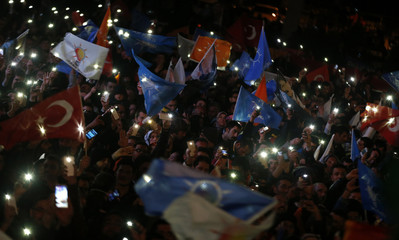 Supporters of Turkey's Prime Minister Tayyip Erdogan celebrate their election victory in Ankara