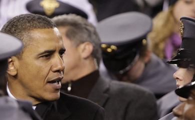 U.S. President Barack Obama talks to army cadets as he attends the 2011 Army vs Navy football game in Landover