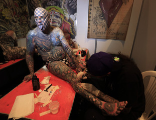 """Matt Gone, also known as """"The Checkered Man"""", is tattooed during a tattoo convention in Bogota"""