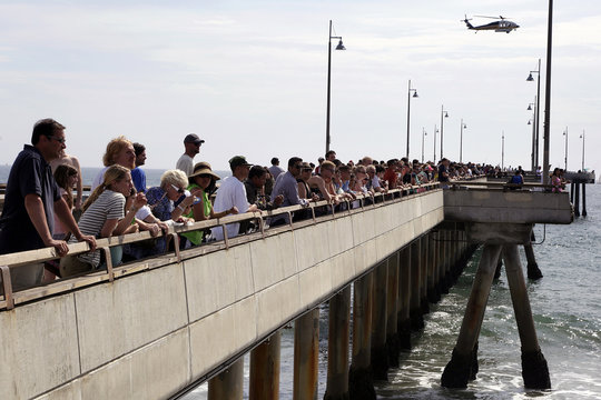 Rescue helicopter searches near the pier for victims of a lightning strike that injured multiple people in Venice
