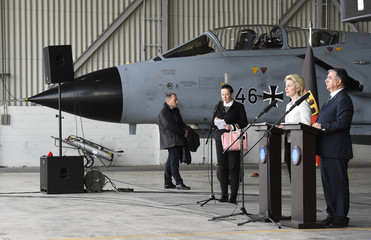 German Defence Minister von der Leyen and Turkish Defence Minister Yilmaz give a statement to the media next to a German Tornado jet during a visit at the air base in Incirlik