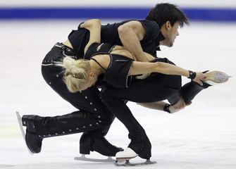 Volosozhar and Trankov of Russia perform during the pairs short program at the ISU World Figure Skating Championships in Nice