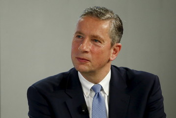 File photo of Alcoa chairman and chief executive Kleinfeld listening during a session in the Swiss mountain resort of Davos