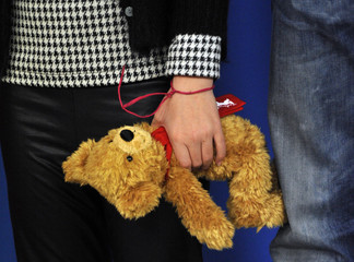 Cast member Perez holds a Teddy bear as she poses during a photocall to promote the movie 'Dictado' at the 62nd Berlinale International Film Festival in Berlin