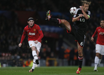 Bayer Leverkusen's Rolfes blocks a shot from Manchester United's Rooney during their Champions League soccer match at Old Trafford in Manchester