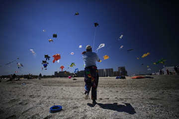 Dibble of Britain pulls down a kite during the country's first international Black Sea Kite Festival at Mamaia